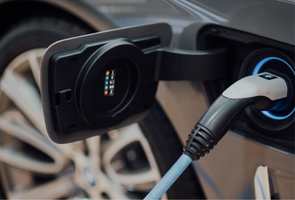 A charging cord charging a car