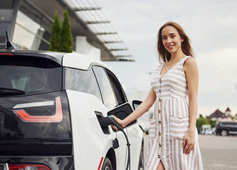 Woman charging an electric car